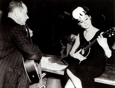Audrey learning to play Moon River on the set of Breakfast at Tiffany's