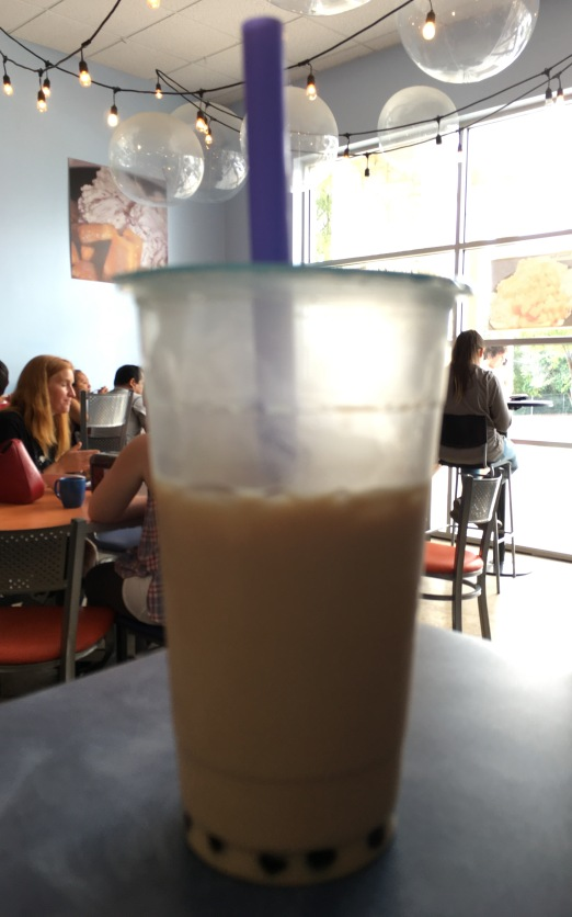 Milk Bubble Tea, with a few sips taken.